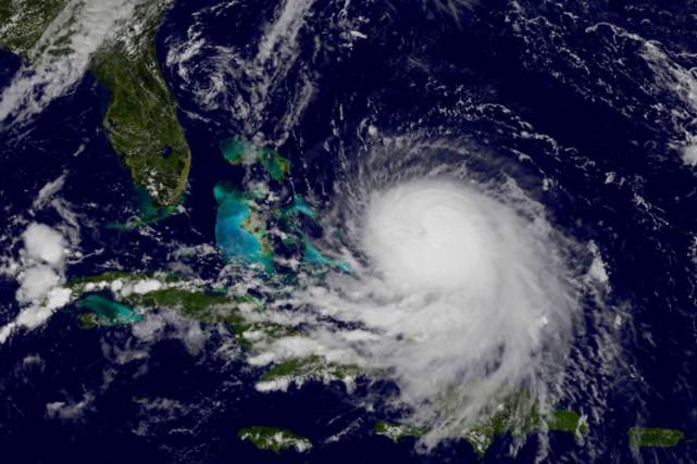 Soufflant des vents atteignant 165 km/h, l'ouragan Joaquin est passé... (PHOTO AFP)
