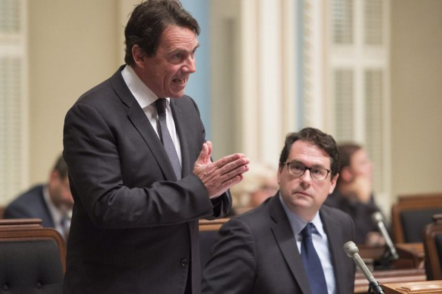 Pierre Karl Péladeau et Bernard Drainville... (PHOTO JACQUES BOISSINOT, ARCHIVES LA PRESSE CANADIENNE)