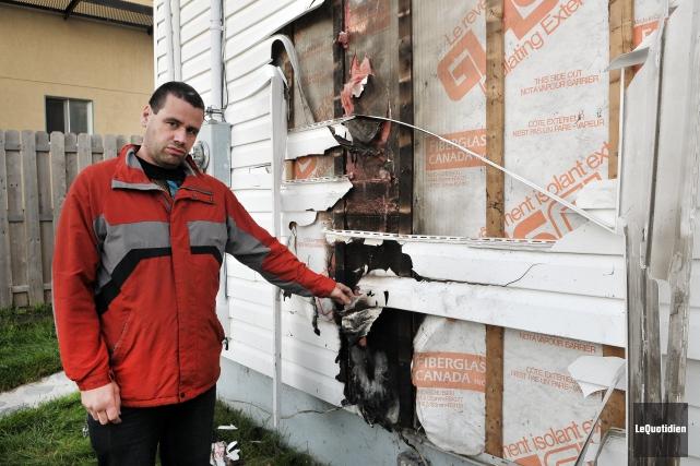 Le propriétaire de la résidence endommagée, Alexandre Guérin,... ((Photo Le Quotidien-Rocket Lavoie))