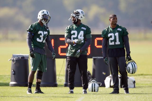 Les joueurs des Jets de New York se... (Photo Matt Dunham, AP)