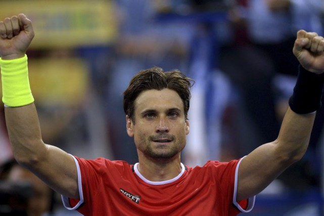 Spain's David Ferrer celebrates after defeating Germany's Benjamin... (MANAN VATSYAYANA)