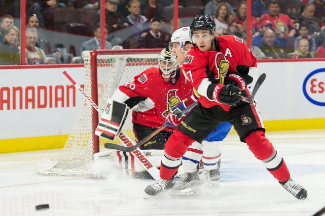 Kyle Turris dirige la rondelle vers la bande... (Photo Marc DesRosiers, USA Today)