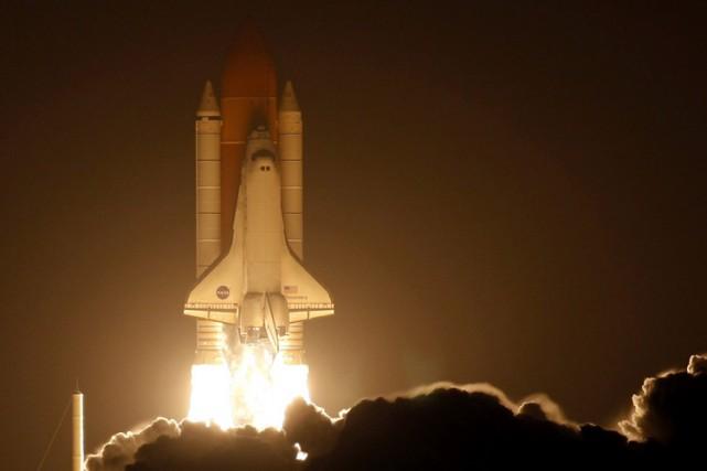 Décollage de la navette spatiale Discovery en mars... (ARCHIVES REUTERS)