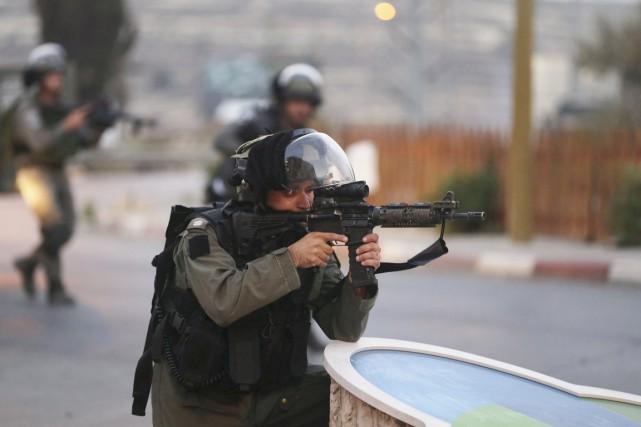 Selon le Croissant-Rouge palestinien, plus de 150 Palestiniens... (PHOTO MOHAMAD TOROKMAN, REUTERS)