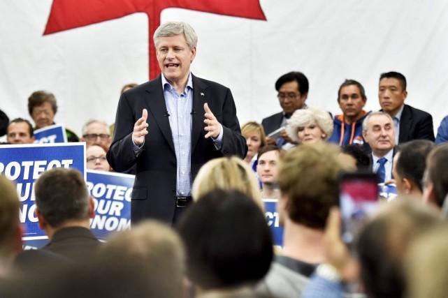 Le chef conservateur Stephen Harpera vanté les vertus... (Photo Nathan Denette, PC)