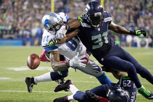 Kam Chancellor (31), des Seahawks, a fait perdre le... (Photo Elaine Thompson, AP)