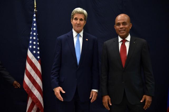John Kerry a rencontréle président haïtien Michel Martelly... (PHOTO AFP)