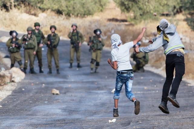 Les confrontations entre lanceurs de pierre palestiniens (souvent... (PHOTO MUSA AL SHAER, AFP)
