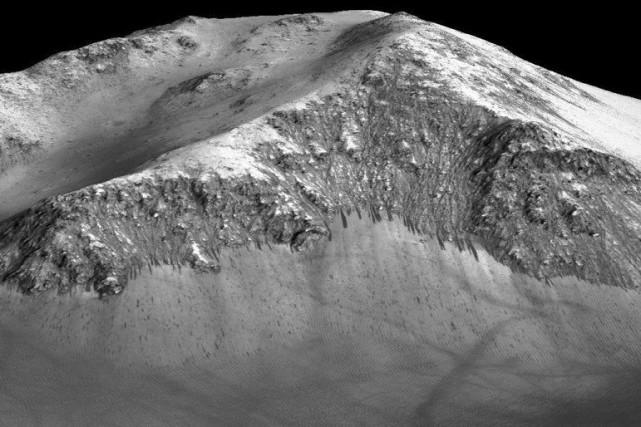 Pour les chercheurs, la présence d'eau sur Mars... (PHOTO NASA / AGENCE FRANCE-PRESSE)