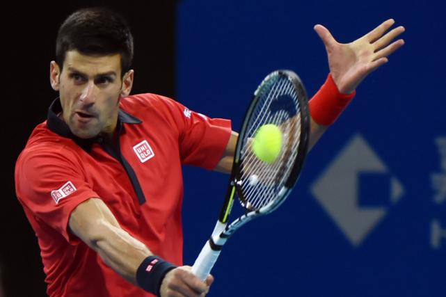Novak Djokovica maintenant gagné 23 sets consécutifs.... (Photo Goh Chai Hin, AFP)