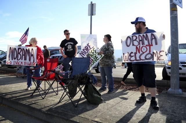 Des activistes pour le port d'armes attendaient le... (AP, Ryan Kang)