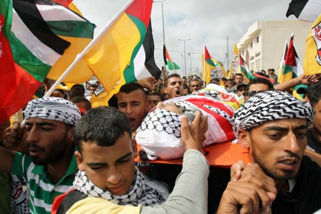 Le cortège funéraire de l'un des quatre Palestiniens... (PHOTO HAZEM BADER, AFP)