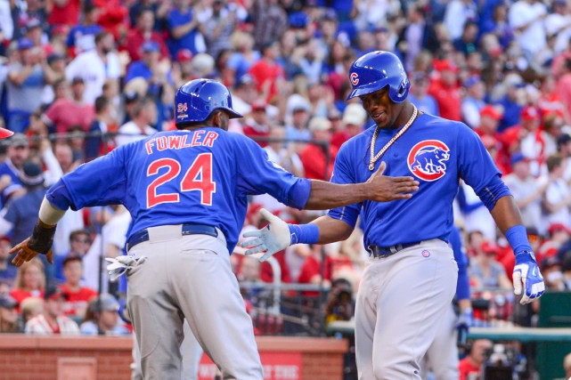 Jorge Soler est félicité par Dexter Fowler après... (PHOTO JEFF CURRY, USA TODAY)