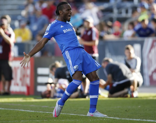 DidierDrogba compte maintenant neuf buts en neuf matchs.... (AP, David Zalubowski)
