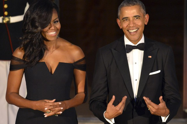 Michelle et Barack Obama... (Photo Mike Theiler, Reuters)