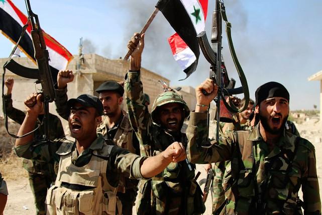 Des soldats qui ont repris la ville Anchan,... (Photo Alexander Kots, AP)