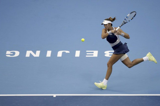 Garbine Muguruza... (PHOTO JASON LEE, REUTERS)