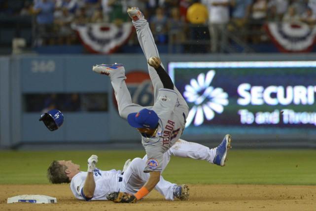 Frappé par Chase Utley dans saglissade,RubinTejada s'est fracturé... (Photo Jayne Kamin-Oncea, USA TODAY Sports)