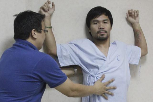 Manny Pacquiao avait été opéré des ligaments de... (Photo AFP)