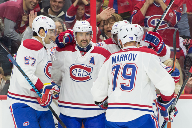 Tomas Plekanec (au centre) a marqué deux buts... (Photo Marc DesRosiers, USA Today)