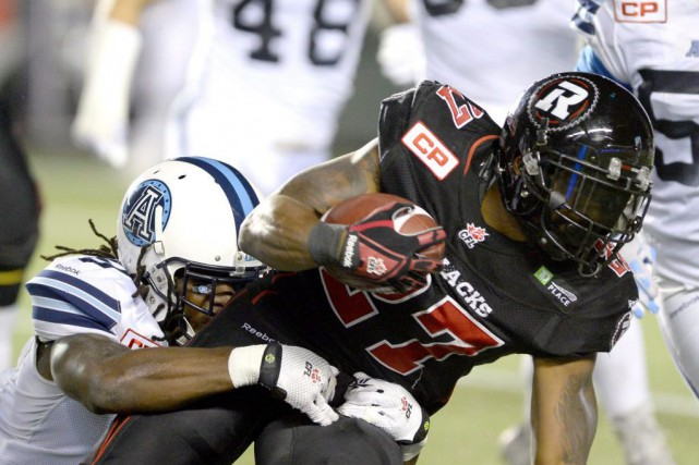 Le demi offensif Jeremiah Johnsons'est disloqué le pied... (Justin Tang, Archives La Presse Canadienne)