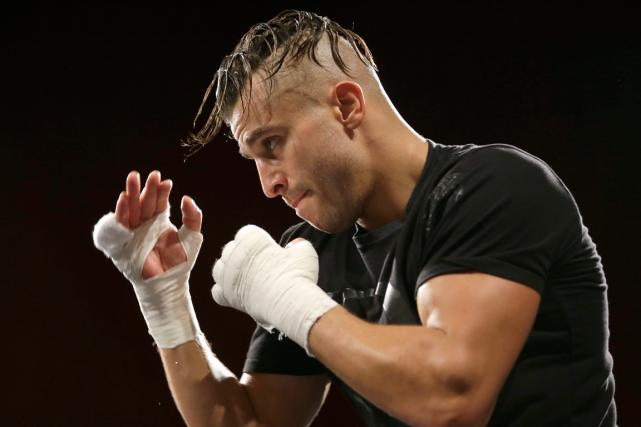 David Lemieuxtentera de ravir les titres du WBC,... (Photo Seth Wenig, AP)