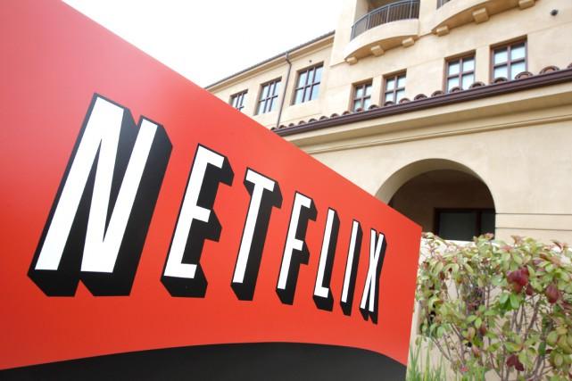 Le service américain de vidéo en ligne Netflix a l'intention de doubler ses... (AP, Paul Sakuma)