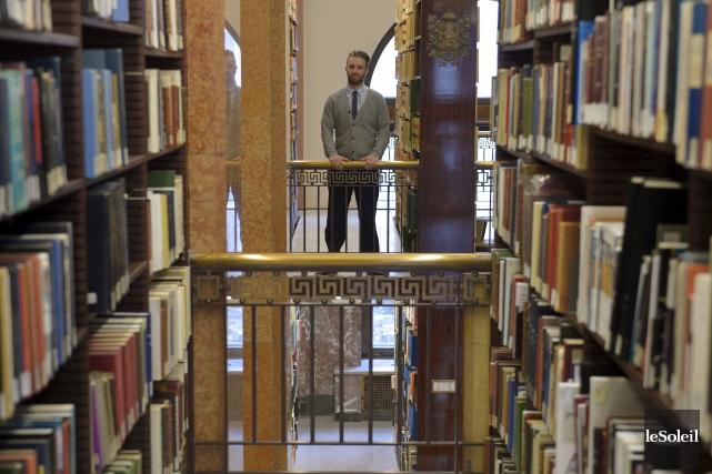 Le bibliothécaire de référence Martin Pelletier se tient... (Le Soleil, Yan Doublet)