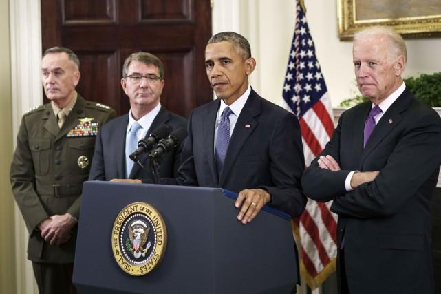 Le président Obama a annoncé le maintien des... (PHOTO BRENDAN SMIALOWSKI, AFP)