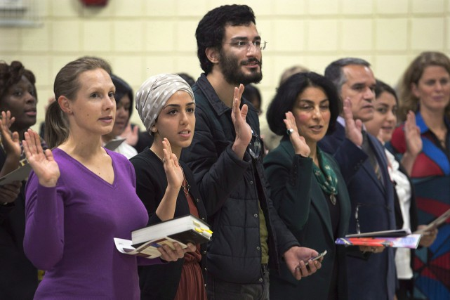 New Canadians take the oath of citizenship at... (PC, Andrew Vaughan)
