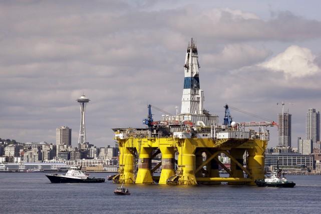 Dix compagnies pétrolières et gazières mondiales se sont... (Elaine Thompson, Archives Associated Press)