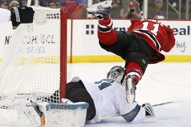 Martin Jones et Stephen Gionta... (Photo Julio Cortez, AP)
