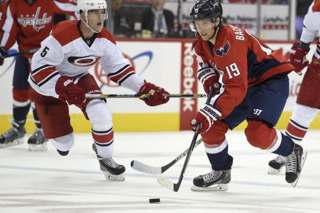 Nicklas Backstrom a amassé un but et deux aides à son premier match de la... (Photo Nick Wass, AP)