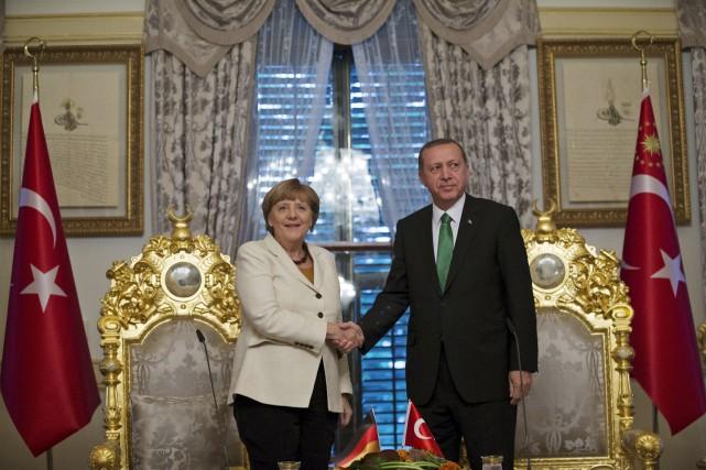 La chancelière allemande s'estentretenue avec le président islamo-conservateur... (AP)