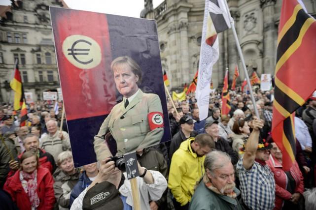Depuis quelques semaines, Angela Merkel est devenue la... (PHOTO AFP)