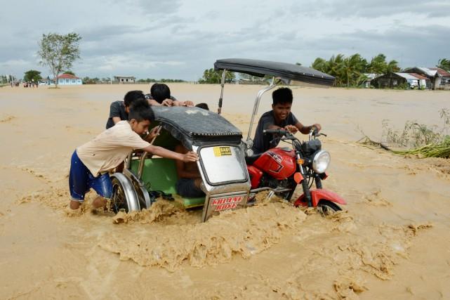 Les Philippines subissent régulièrement des intempéries meurtrières, avec... (PHOTO TED ALJIBE, AFP)