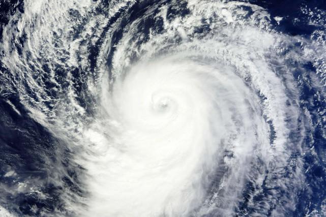 Le NHC a prévenu qu'Olaf pourrait devenir un... (IMAGE AFP/NASA)