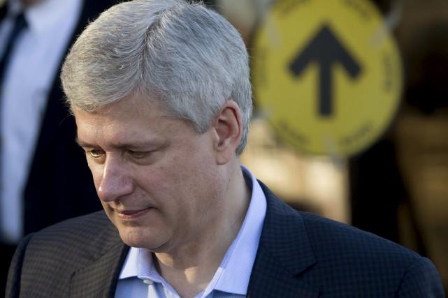 Le chef du Parti conservateur, Stephen Harper, sort... (La Presse Canadienne, Darryl Dick)
