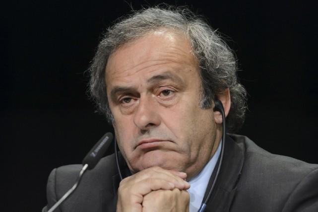 Michel Platini... (AFP, Fabrice Coffrini)