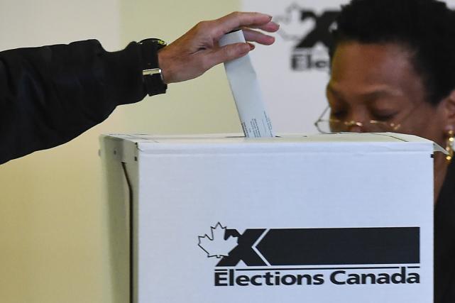Près de 17,6 millions de Canadiens se sont... (Photo Nicholas Kamm, AFP)