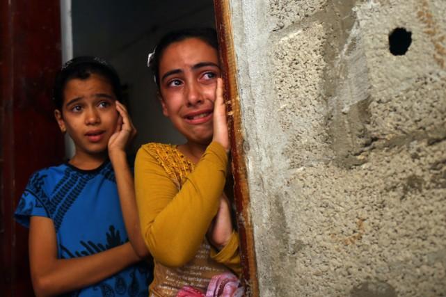 Les enfants d'un Palestinien tué par les forces... (PHOTO AFP)