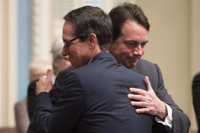 Stéphane Bédard et Pierre Karl Péladeau... (PHOTO JACQUES BOISSINOT, LA PRESSE CANADIENNE)