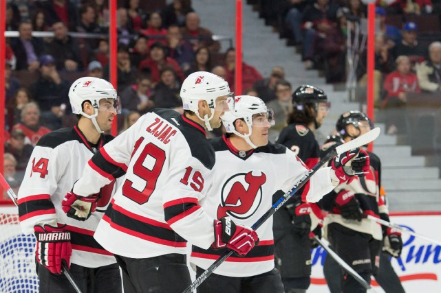 En déficit 4-2 en troisième période, les Devils... (Photo Marc DesRosiers, USA Today)