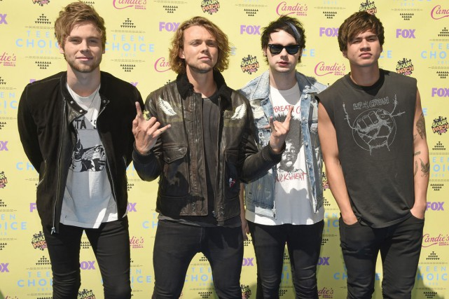 Luke Hemmings, Ashton Irwin, Michael Clifford et Calum... (PHOTO ARCHIVES AP)