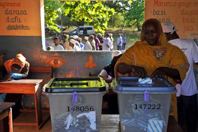 Les résultats préliminaires de ces élections présidentielle, législatives... (PHOTO TONY KARUMBA, AFP)