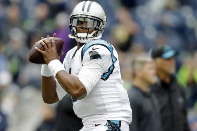 Cam Newton... (PHOTO STEPHEN BRASHEAR, ASSOCIATED PRESS)