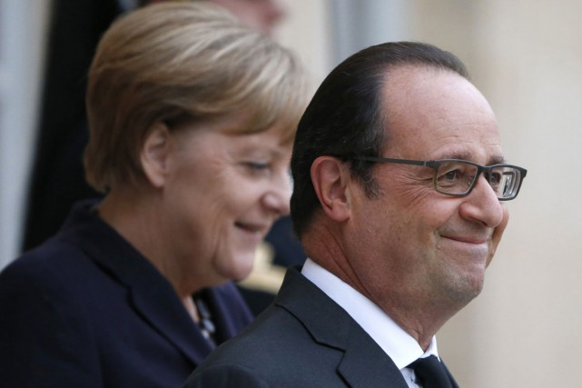 La chancelière allemande Angela Merkel et le président... (PHOTO REUTERS)
