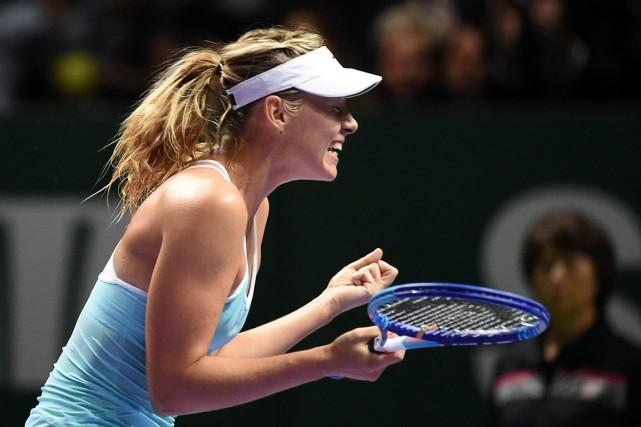 Maria Sharapova a battuSimona Halep 6-4 et 6-4... (AFP, Roslan Rahman)