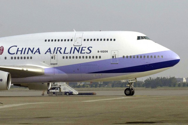 Près de la moitié des vols quittant l'aéroport international de Shanghai ont... (PHOTO ARCHIVES AP)