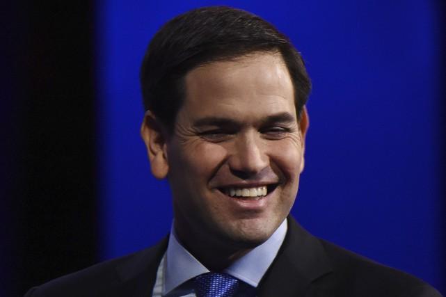 S'il continue sur sa lancée, le candidat Marco... (AFP, Robyn Beck)